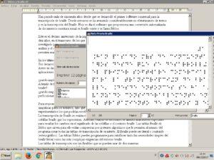 Imagen de una ventana en primer plano con los puntos braille. A un lado, debajo, está la ventana de Biblos. En ambas ventanas está el texto del artículo, en braille y en caracteres visuales.