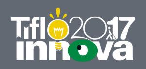 """Imagen con el logotipo de Tifloinnova 2017. Éste está compuesto por las palabras """"Tiflo"""", en la que la letra """"O"""" es una bombilla amarilla, a su derecha la cifra 2017, en cuyo """"1"""" está el logotipo de la ONCE, y debajo se encuentra la palabra """"Innova"""", en la que la letra """"O"""" es un ojo de color verde. El fondo de este logotipo es gris y las letras son blancas."""